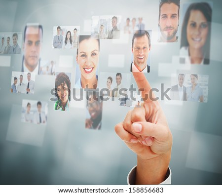 Close up of a man selecting a profile picture on digital screen