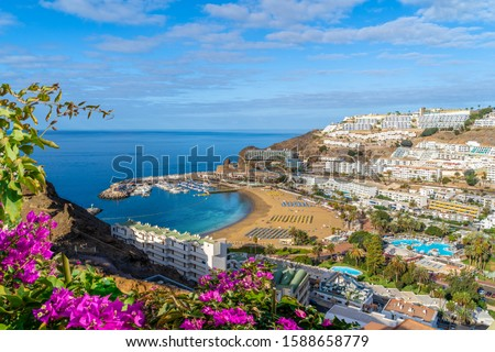 Landscape with  Puerto Rico village and beach on Gran Canaria, Spain Royalty-Free Stock Photo #1588658779