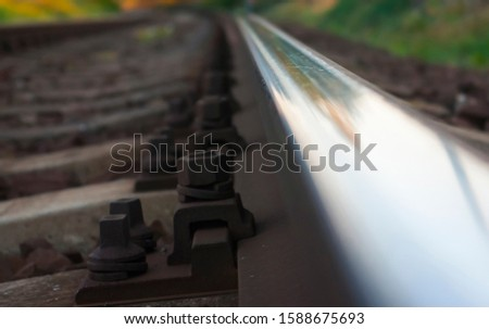 Rail track, fastening screws, speed evokes the whole picture. View ahead along the railroad track. Maybe the way to the future, the speed of decision making.