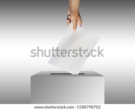 concept vote election Election of members of parliament, president, chief, executive. a ballot paper in hand isolated with clipping path on background #1588798702