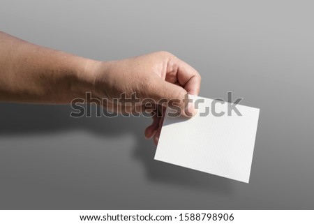 concept vote election Election of members of parliament, president, chief, executive. a ballot paper in hand isolated with clipping path on background #1588798906