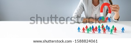 Businessperson Attracting Human Figures With Horseshoe Magnet #1588824061