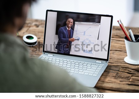 Man Participating In Online Coaching Session Using Laptop Royalty-Free Stock Photo #1588827322