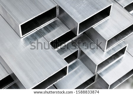 Aluminium profile for windows and doors manufacturing. Structural metal aluminium shapes. Aluminium profiles texture for constructions. Aluminium constructions factory background. Royalty-Free Stock Photo #1588833874