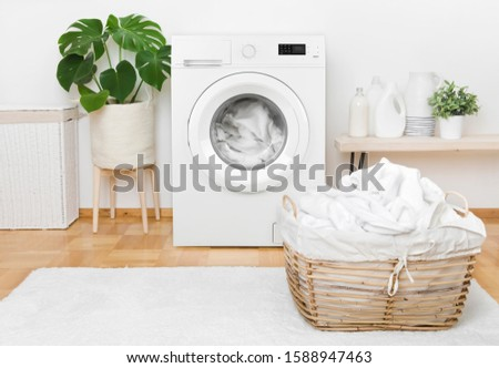Laundry in washing machine and basket, interior of pastel colors #1588947463