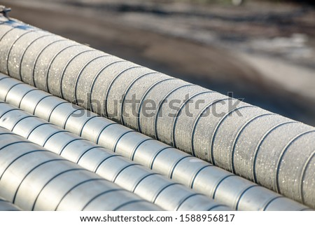 Ground heating pipes in winter-close-up. Frost on the heat pipe. #1588956817