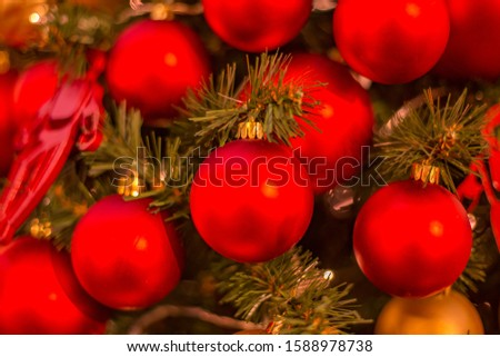 Christmas tree with gold bauble ornaments. Decorated Christmas tree closeup. Balls and illuminated garland with flashlights. New Year baubles macro photo with bokeh. Winter holiday light decoration #1588978738