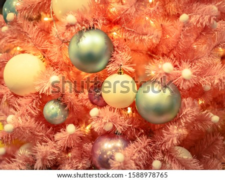 Christmas tree with gold bauble ornaments. Decorated Christmas tree closeup. Balls and illuminated garland with flashlights. New Year baubles macro photo with bokeh. Winter holiday light decoration #1588978765