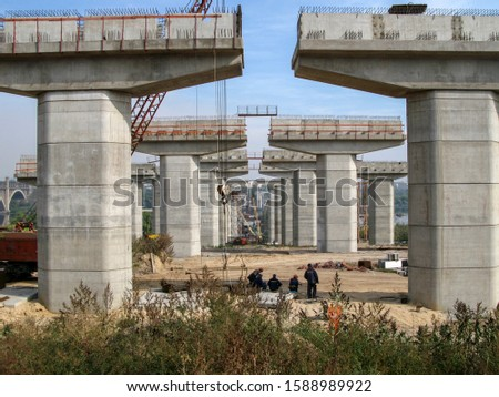 Piers of a bridge under construction in perspective #1588989922