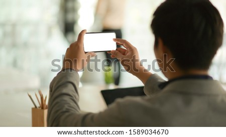 Business people using smartphone blank screen. #1589034670