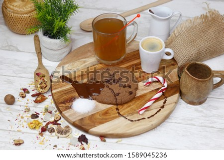 Homemade French dessert, chocolate cookies. Served in a wooden table with decoration, tea and coffee.