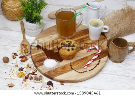 Homemade French dessert, chocolate muffin. Served in a wooden table with decoration, tea and coffee.