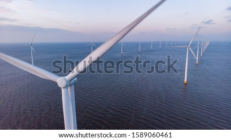 Aerial view of wind turbines at sea, North Holland, Netherlands, Beautiful sunset above the windmills  #1589060461