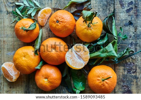 fresh clementines on wooden background #1589093485