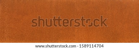 Background rust texture as a panorama homogeneous rust surface made of corten steel Royalty-Free Stock Photo #1589114704