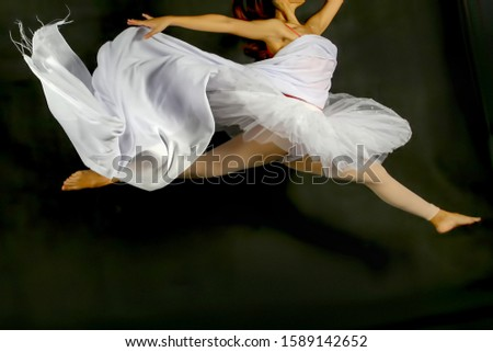 women perform ballet movements with cloth #1589142652