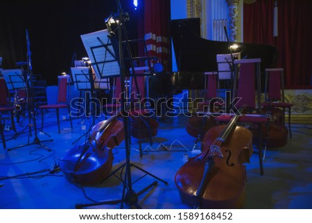 Musical instruments before the concert of the Symphony orchestra #1589168452