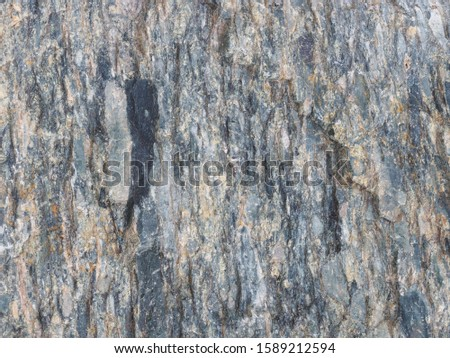 Background from black, gray, yellow old gray stone. Caucasus #1589212594