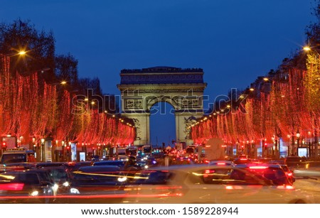 The famous Triumphal Arch and Champs Elysees avenue illuminated for Christmas 2019 ,Paris, France. #1589228944