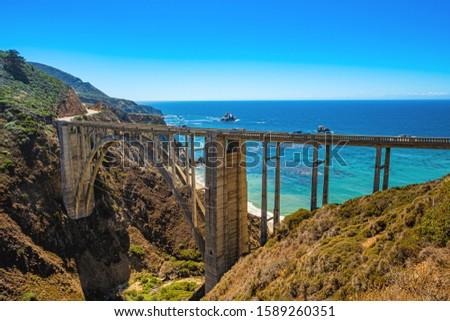 Bixby Bridge, the most photographed bridge on the Pacific Coast. Scenic California Highway 1 Royalty-Free Stock Photo #1589260351