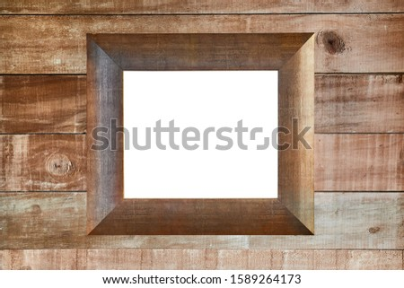 Empty blank picture frame or window on a wooden lumber wall of a cabin
