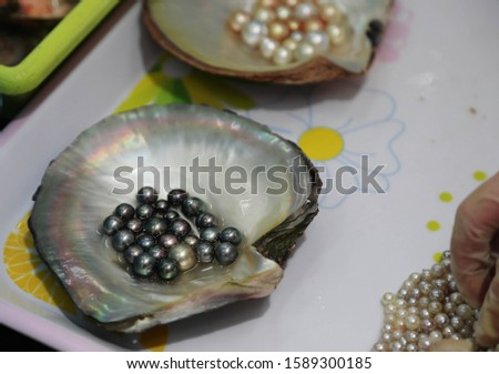 Black cultured pearls sorted and sized  #1589300185