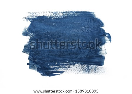 Trendy Color of the year 2020 classic blue. Sample of classic blue paint on white isolated background.Texture of blue paint. Fashionable classic blue  color of spring-summer 2020 season. Royalty-Free Stock Photo #1589310895