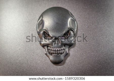 Biker symbols. Emblem of the jaw. Gothick style. Motorcycle decoration. The mascot of bikers. A way to pay off death. Tribute to death. Halloween symbol. The face of the skeleton. #1589320306