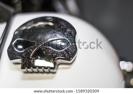 Biker symbols. Emblem of the jaw. Gothick style. Motorcycle decoration. The mascot of bikers. A way to pay off death. Tribute to death. Halloween symbol. The face of the skeleton. #1589320309