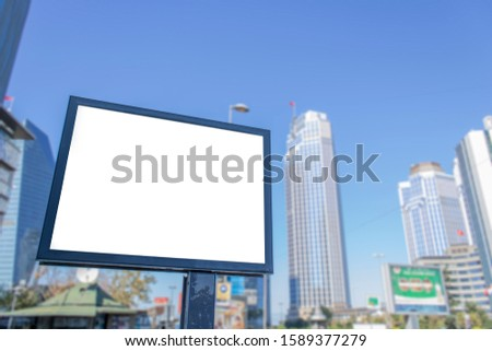 Close-up advertising sign. In white background. It was photographed in Turkey. Photographed on a summer day. financial centers and large skyscrapers on the background.