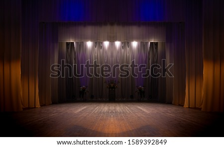 An empty stage of the theater, lit by spotlights and smoke before the performance #1589392849
