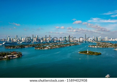Miami, Florida - 23 July 2019: The many islands around Miami beach with stunning views of the city in the distance #1589402908