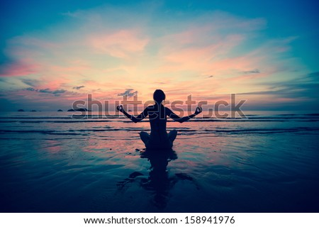 Sunset yoga woman on sea coast (in cold colors) #158941976