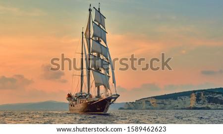 Sailing ship under white sails at sea. Cruises Travel. Yachting #1589462623