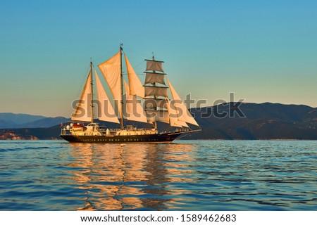 Cruises Travel. Yachting. Sailing ship under white sails at sea #1589462683