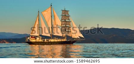 Sailing ship under white sails at sea. Cruises Travel. Yachting. #1589462695