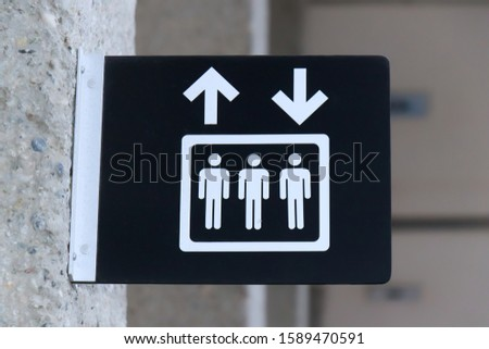 Close up View of Lift (elevator) sign on grey wall background