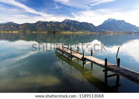 Autumn mood with mountain views on Forggensee lake near Füssen, East Allgäu, Bavaria, Germany #1589513068