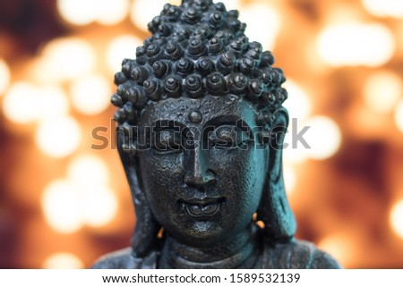 Buddha head in bronze with lights background #1589532139