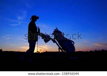 Golf, woman golfer with golf bag at sunset, as backgrounds #158956544