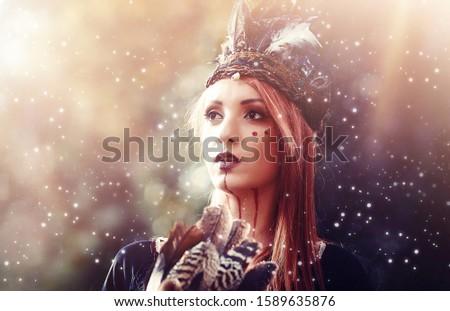 beautiful shamanic woman with headband in the nature.