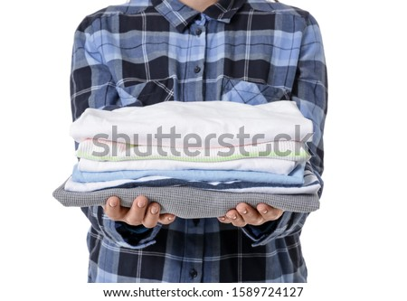 Young woman with clean clothes on white background, closeup #1589724127