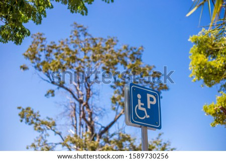 Sign indicating the convenience status of the disabled #1589730256