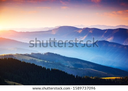 Calm evening landscape in the mountains at sunset. Picture of colorful cloudy sky. Location place of Carpathian national park, Ukraine, Europe. Idyllic natural wallpaper. Discover the beauty of earth. #1589737096