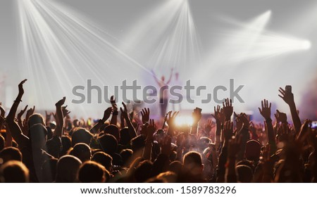 crowd with raised hands at concert festival banner #1589783296