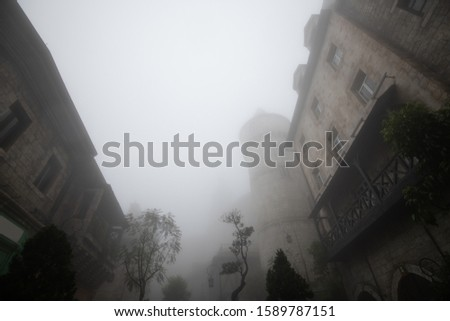 Old building in french village in the mist,Danang,Vietnam #1589787151