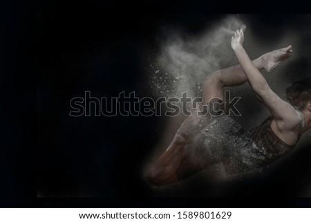men do gymnastics movements with splashes of powder  #1589801629