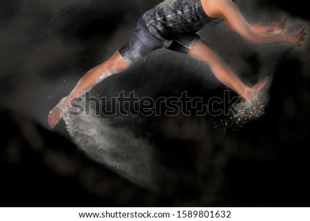 woman do gymnastics movements with splashes of powder   #1589801632