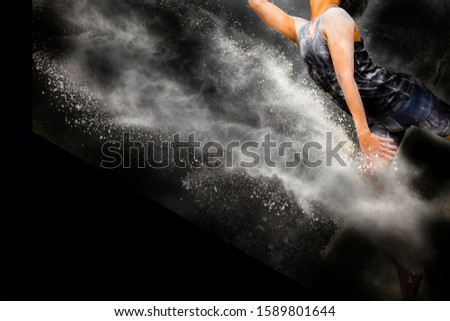 men do gymnastics movements with splashes of powder  #1589801644