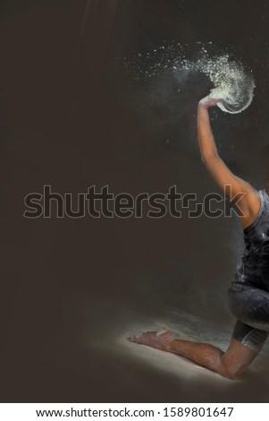 men do gymnastics movements with splashes of powder  #1589801647